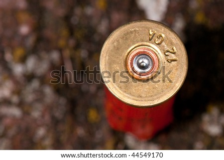 Closeup of fired shotgun cartridge - stock photo