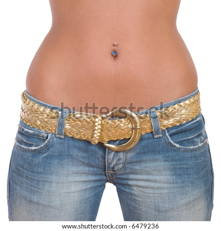 Closeup of fit girl in blue jeans with golden belt - over a white background