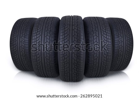 Closeup of five vehicle tires with black color in the studio, isolated on white background - stock photo