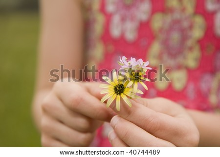 Closeup of flowers in hands of young girl