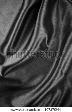 Closeup of folds in black silk fabric - stock photo