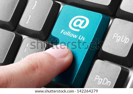 Closeup of follow us button on the keyboard - stock photo