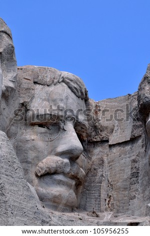 Closeup of former U.S. president Theodore Roosevelt at the Mount Rushmore National Memorial in South Dakota - stock photo