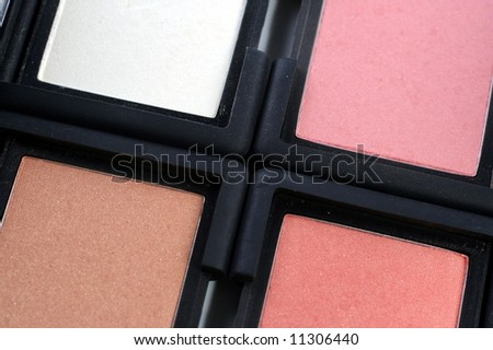closeup of four colored blush makeup compacts - stock photo