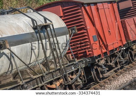 closeup of freight wagons on a railroad track - stock photo