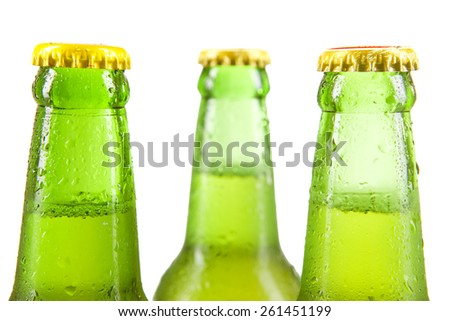 Closeup of fresh beer in the bottles with green color, isolated over white - stock photo
