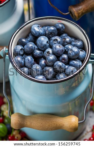 Closeup of fresh berry fruits in churn - stock photo