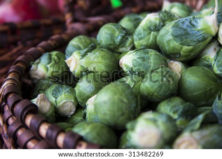 Closeup of fresh brussels sprouts in a basket  - stock photo
