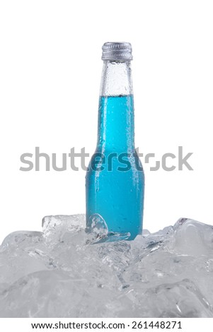 Closeup of fresh drink with blue color in the bottle over ice cube, isolated on white background - stock photo