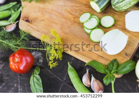 Closeup of fresh farmers market locally grown organic chopped vegetables on a cutting board. Wooden background.
