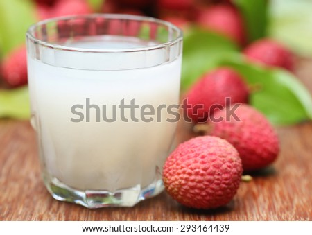 Closeup of fresh lychee juice with fruits  - stock photo