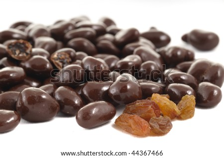 Closeup of fresh raisins in chocolate - stock photo