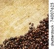 Closeup of fresh roasted coffee beans on traditional rough sack textile background, square - stock photo