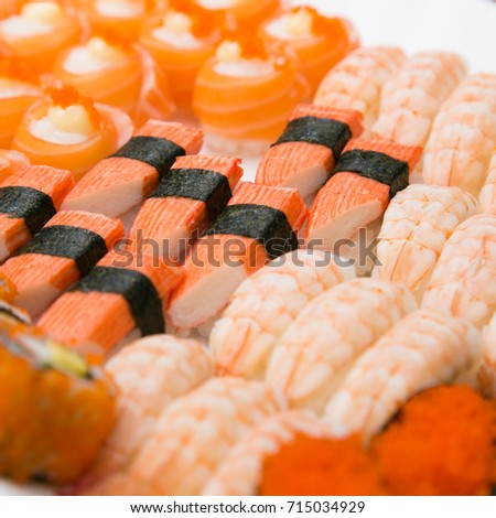 Closeup of fresh salmon sushi , salmon maki roll.Japanese food