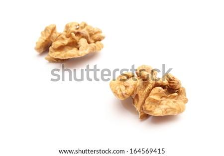 Closeup of fresh walnut without shell isolated on white background - stock photo
