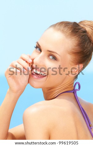 Closeup of fresh young woman with beautiful smile - stock photo