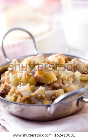 Closeup of freshly baked bread pudding in a metal pan.