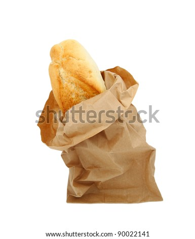 Closeup of freshly baked bread sticking out of paper bag isolated with clipping path - stock photo