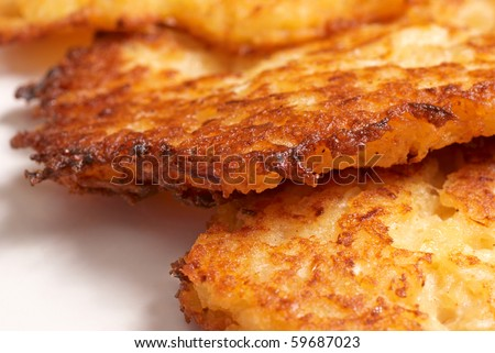 Closeup of freshly fried latkes, traditional jewish food - stock photo