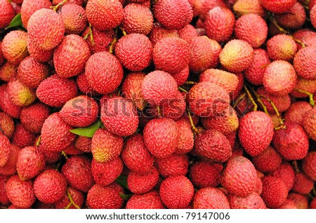 Closeup of freshly produced bunch of ripe and delicious Lychee fruits - stock photo