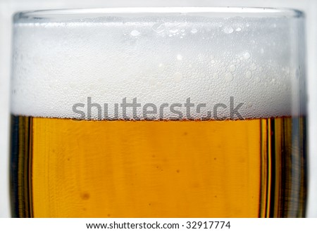 closeup of freshly tapped beer - stock photo