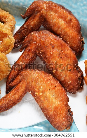 Closeup of fried chicken wings on a plate  - stock photo