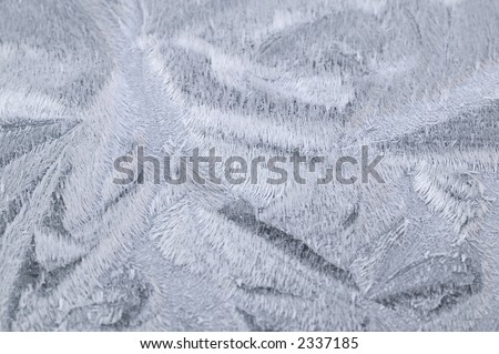 Closeup of frost patterns on a car bonnet. - stock photo