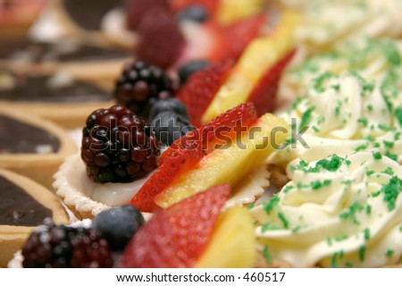 Closeup of fruit and sweet treats, featuring berries, pineapple, chocolate - stock photo