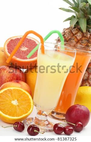 Closeup of fruit juice with fruits - stock photo