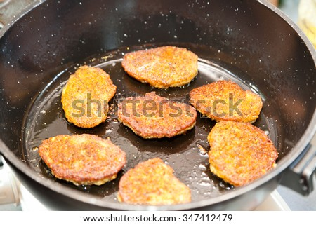 Closeup of frying vegetarian cutlets from lentil - stock photo