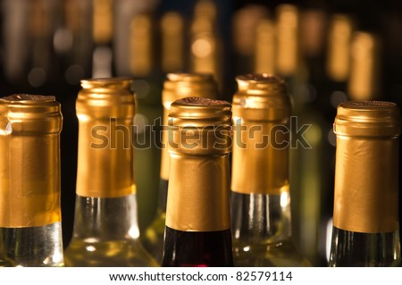 Closeup of full & corked bottles of wine - stock photo
