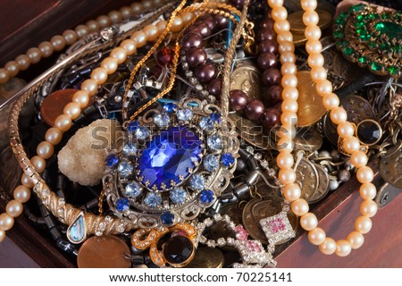 Closeup of full treasure chest with jewellery - stock photo