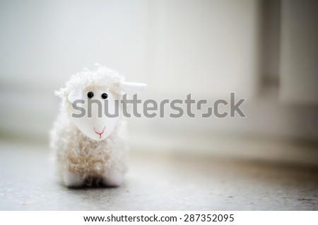 Closeup of funny white sheep puppet - stock photo
