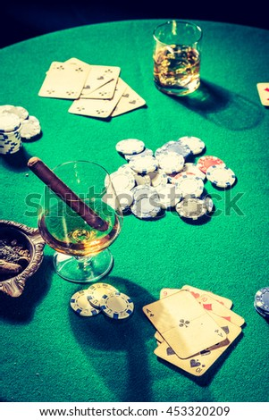 Closeup of gambling table with cards and chips - stock photo