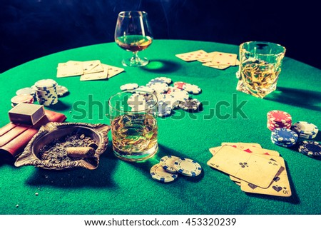 Closeup of gambling table with chips and cards - stock photo