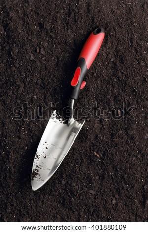 Closeup of gardening shovel on soil - stock photo