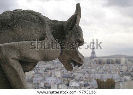 Closeup of gargoyle on top of Notre Dame in Paris France.