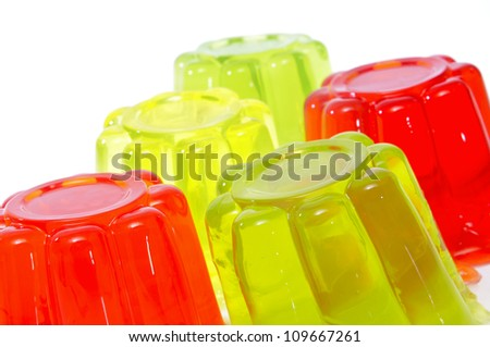 closeup of gelatin of different colors and flavors on a white background - stock photo