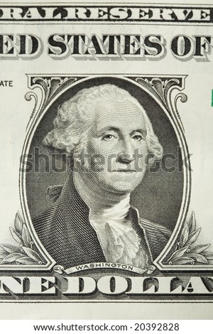 Closeup of George Washington on a one dollar bill in United States Currency - stock photo