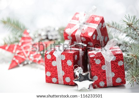 Closeup of gift boxes and pine branch. - stock photo