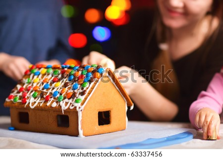 Closeup of gingerbread house decorated with colorful candies - stock photo