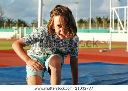 closeup of girl practising high jump - stock photo