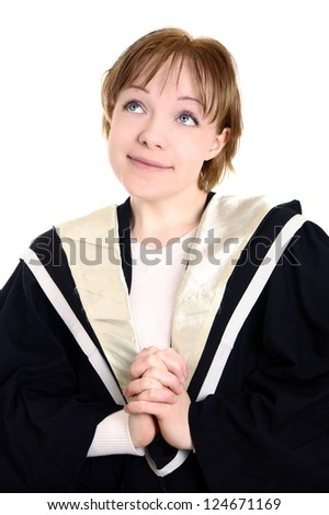closeup of girl wearing graduation gown - stock photo