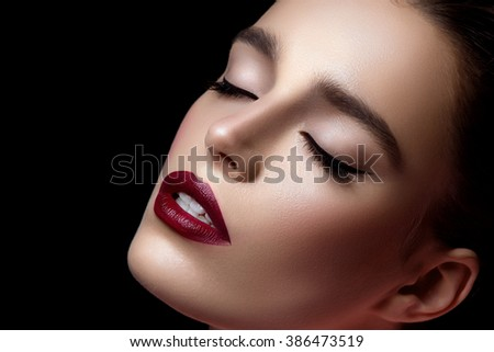 Closeup of girl with dark red lips - stock photo