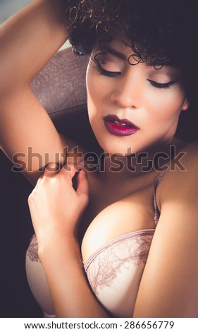 closeup of girls face in lingerie with sensual pose