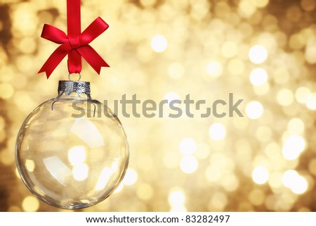 Closeup of glass Christmas ball on abstract light background. - stock photo
