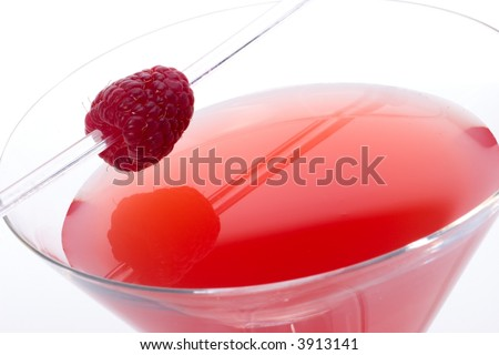 Closeup of glass of French Horn cocktail - raspberry liquor, vodka and lemon juice - garnished with whole raspberry - stock photo