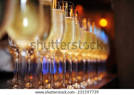 Closeup of glasses of champagne in a row on a table champagne, celebrate, cheer,  cocktail,  glasses - stock photo