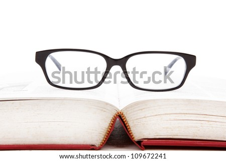 Closeup of glasses on the book. shot in studio isolated on white - stock photo