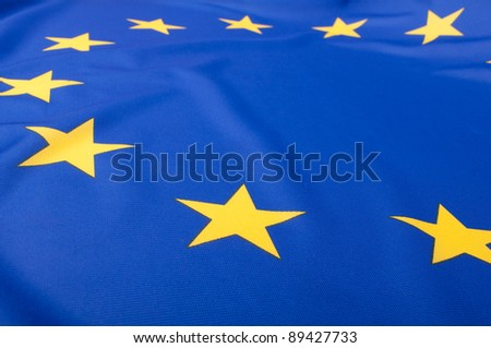 Closeup of Glossy Flag of European Union - EU Flag Drapery - stock photo